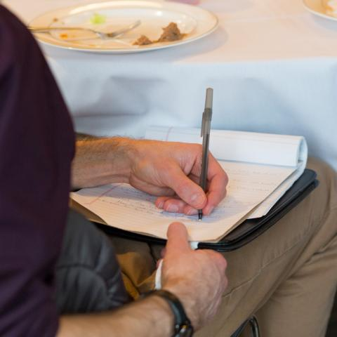 Man writing on note pad