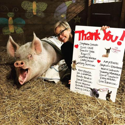 Jen Korz with pig and thank you poster
