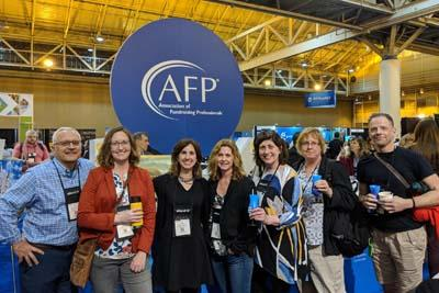 Group of Scholarship winners at AFP conference, breaking for a photo.