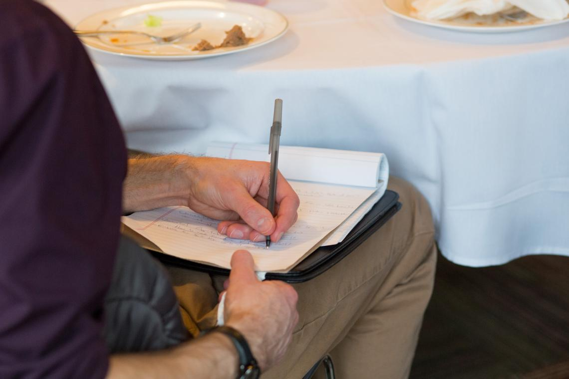 Man writing on pad